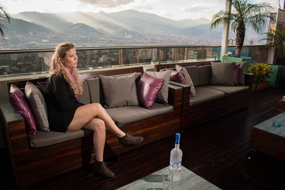 girl on terrace with view of Medellin, luxury penthouse in Medellin