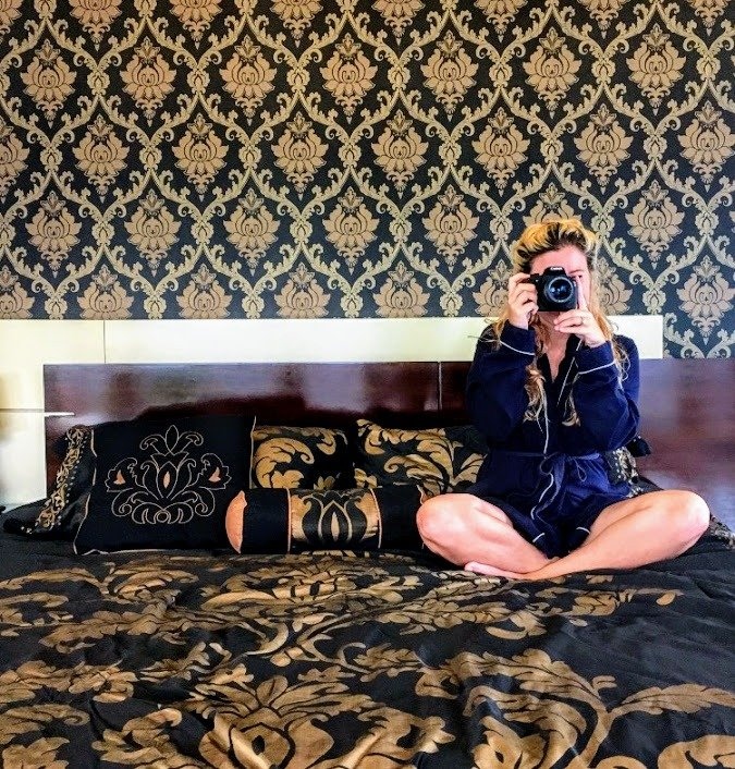 girl with camera in bed