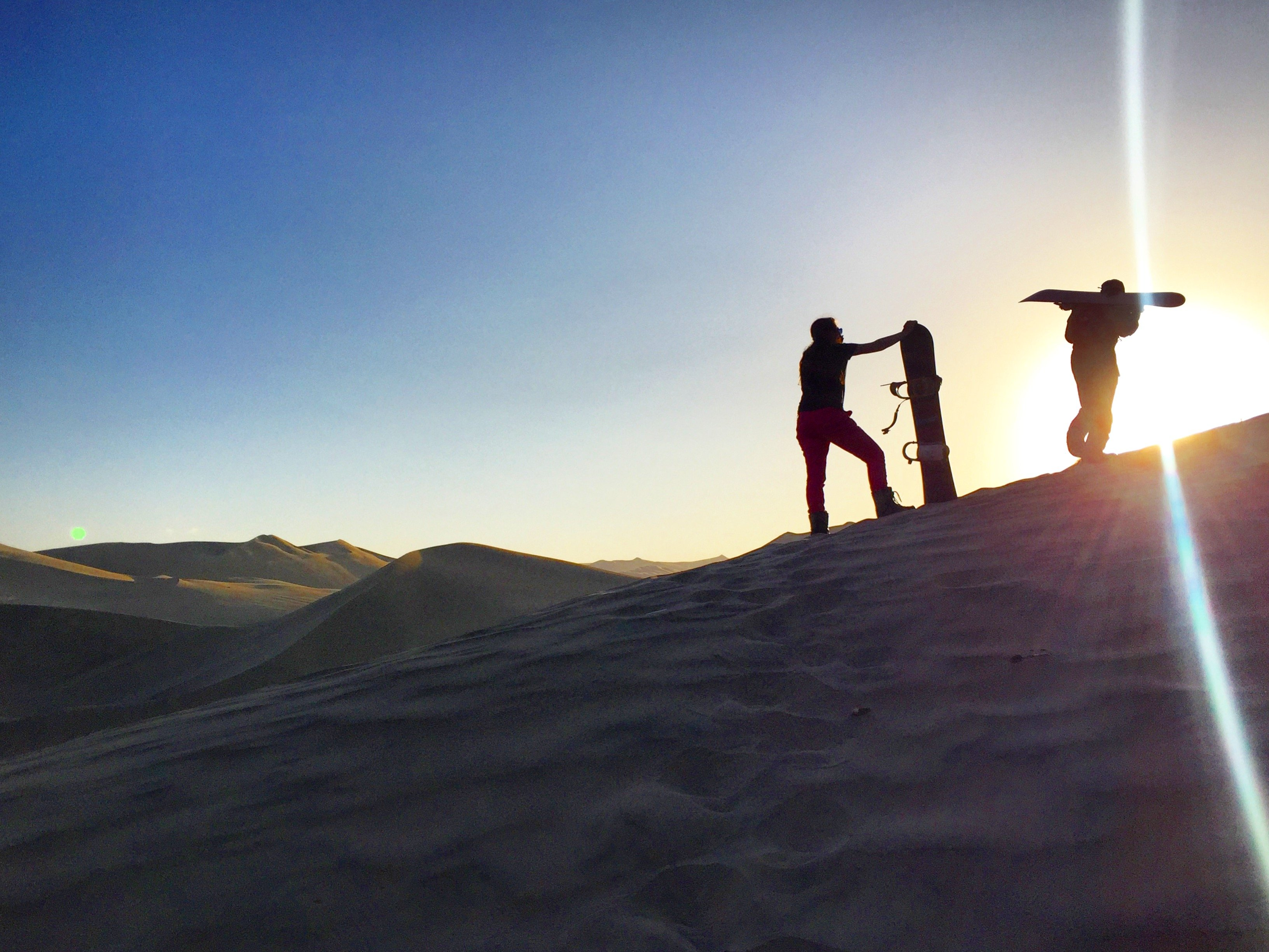 sand boarding in the Huacachina Oasis in Peru