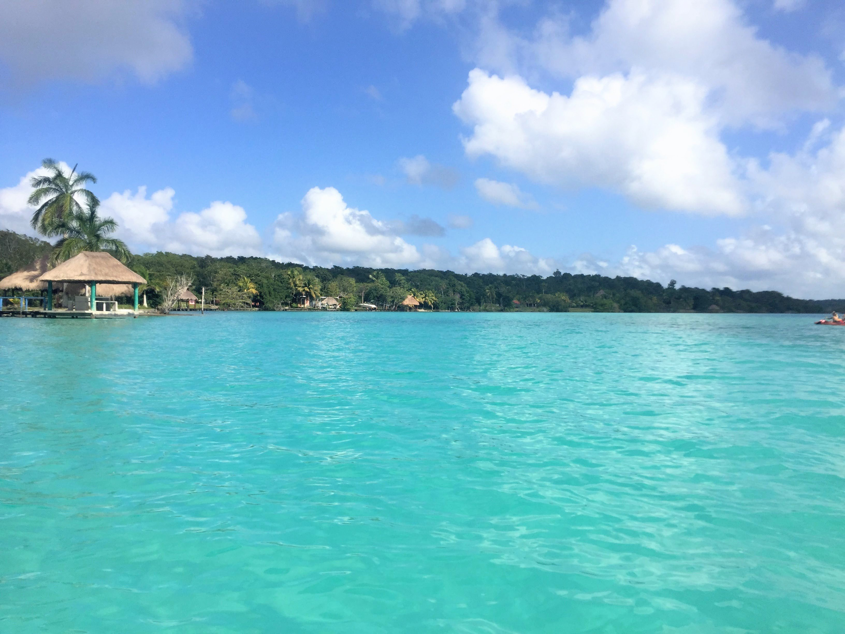 View of the shore and blue waters of laguna bacalar
