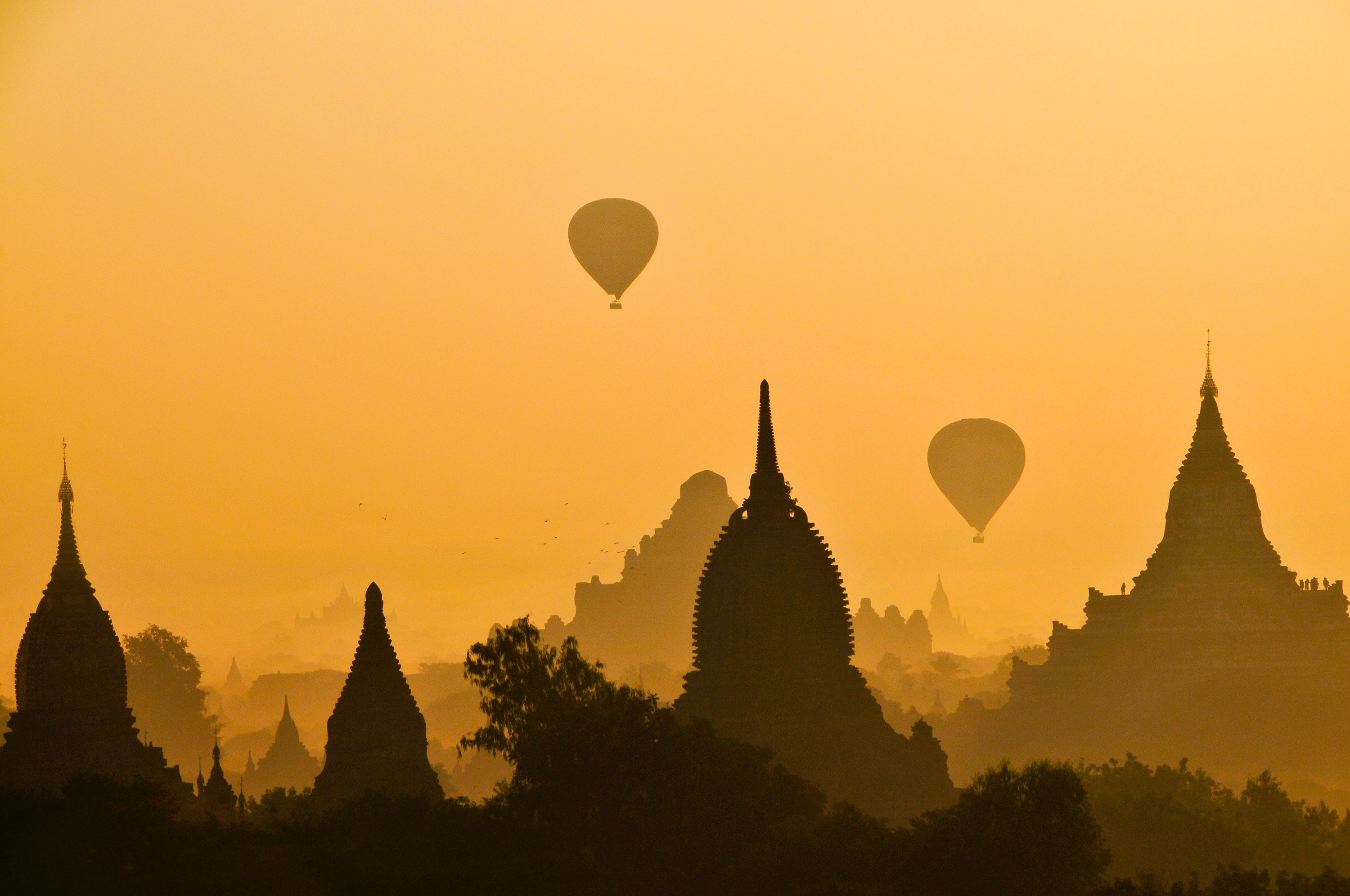 temples and hot air balloons at sunrise