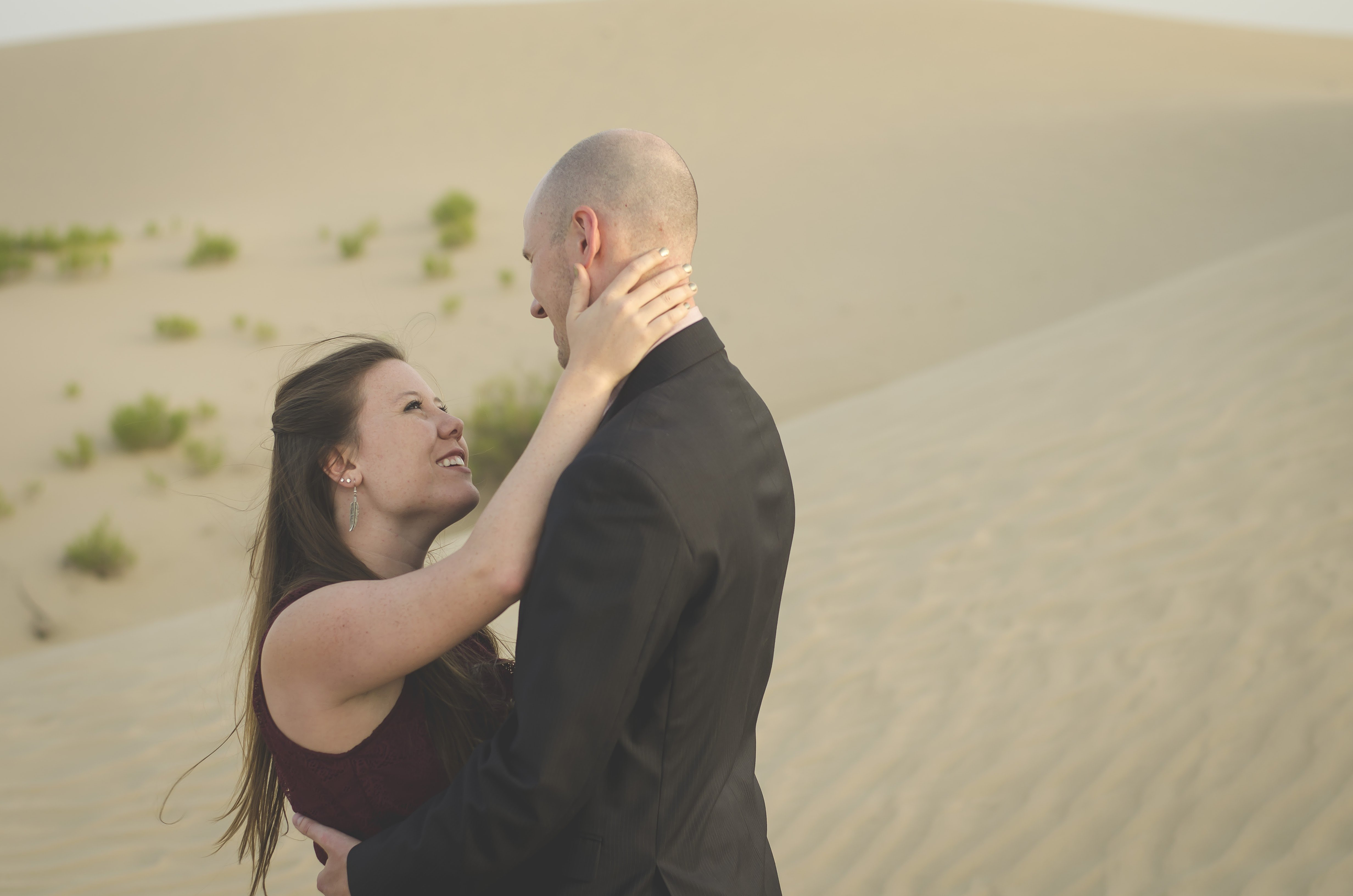couple embracing in a desert engagement photo