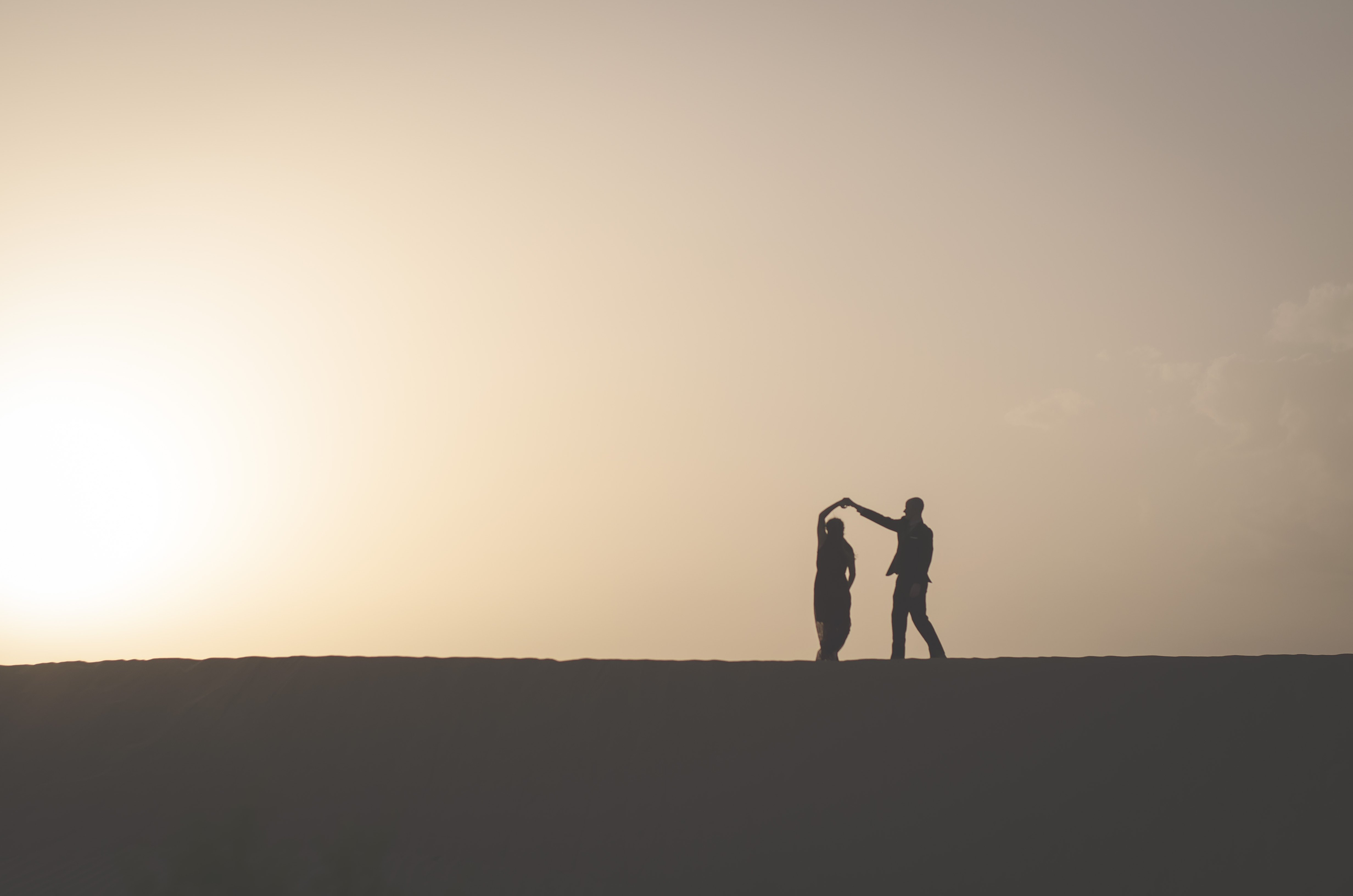couple dancing at sunset in the desert