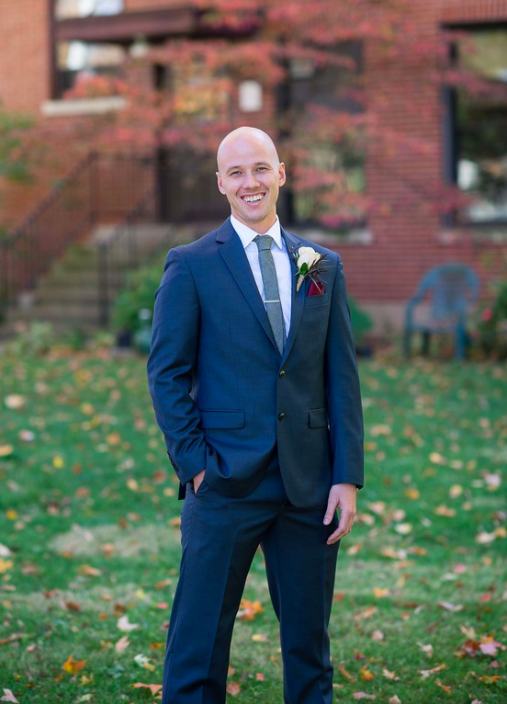 smiling groom in the fall