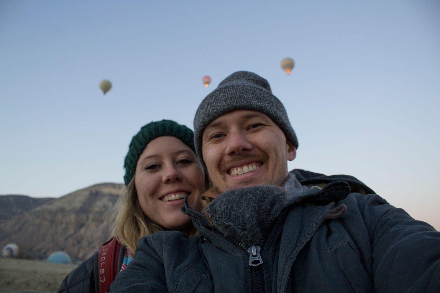 couple with hot air balloons in Cappadocia