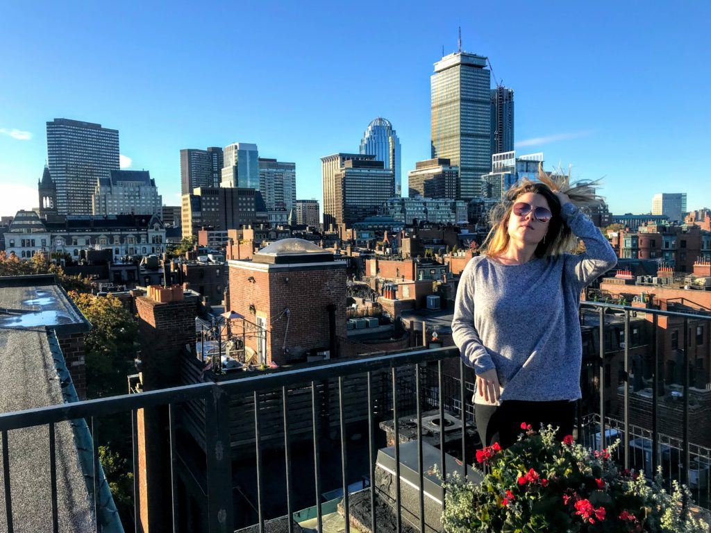 girl in front of Boston skyline