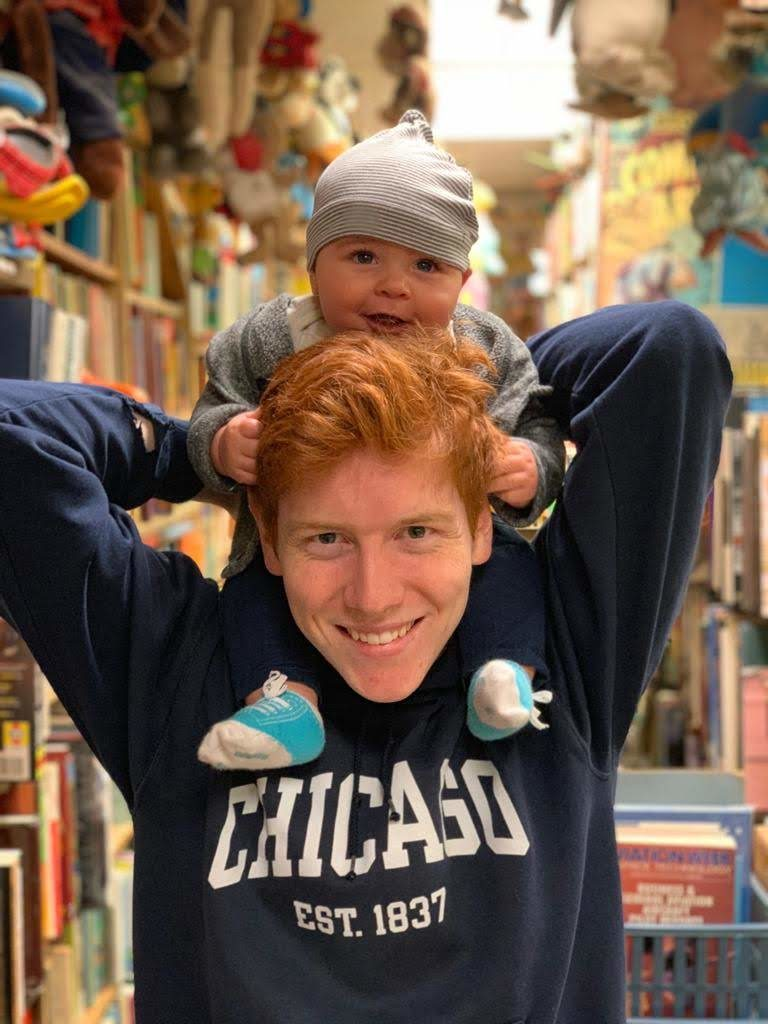 boy and baby in a book store