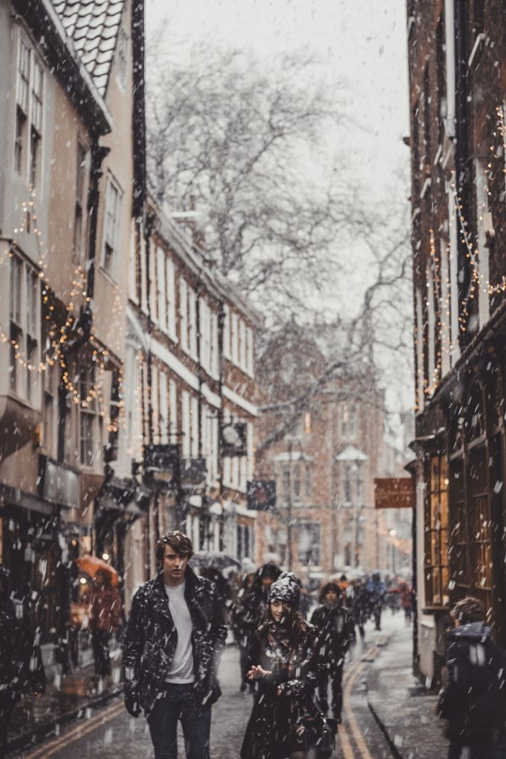 Snowy street in the UK with crowds