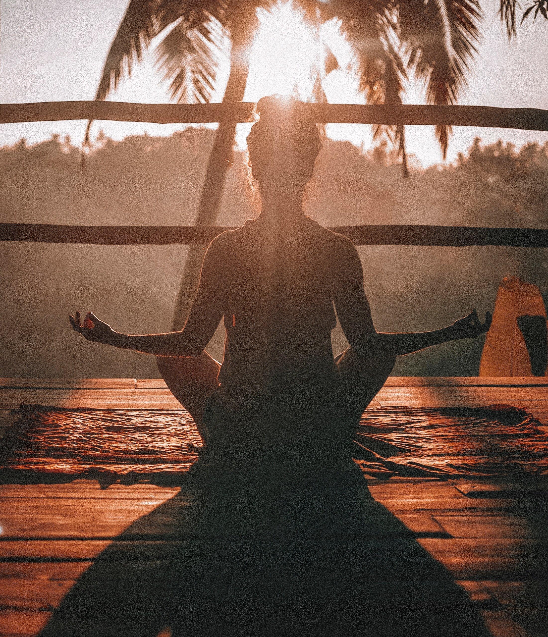 girl meditating at sunrise
