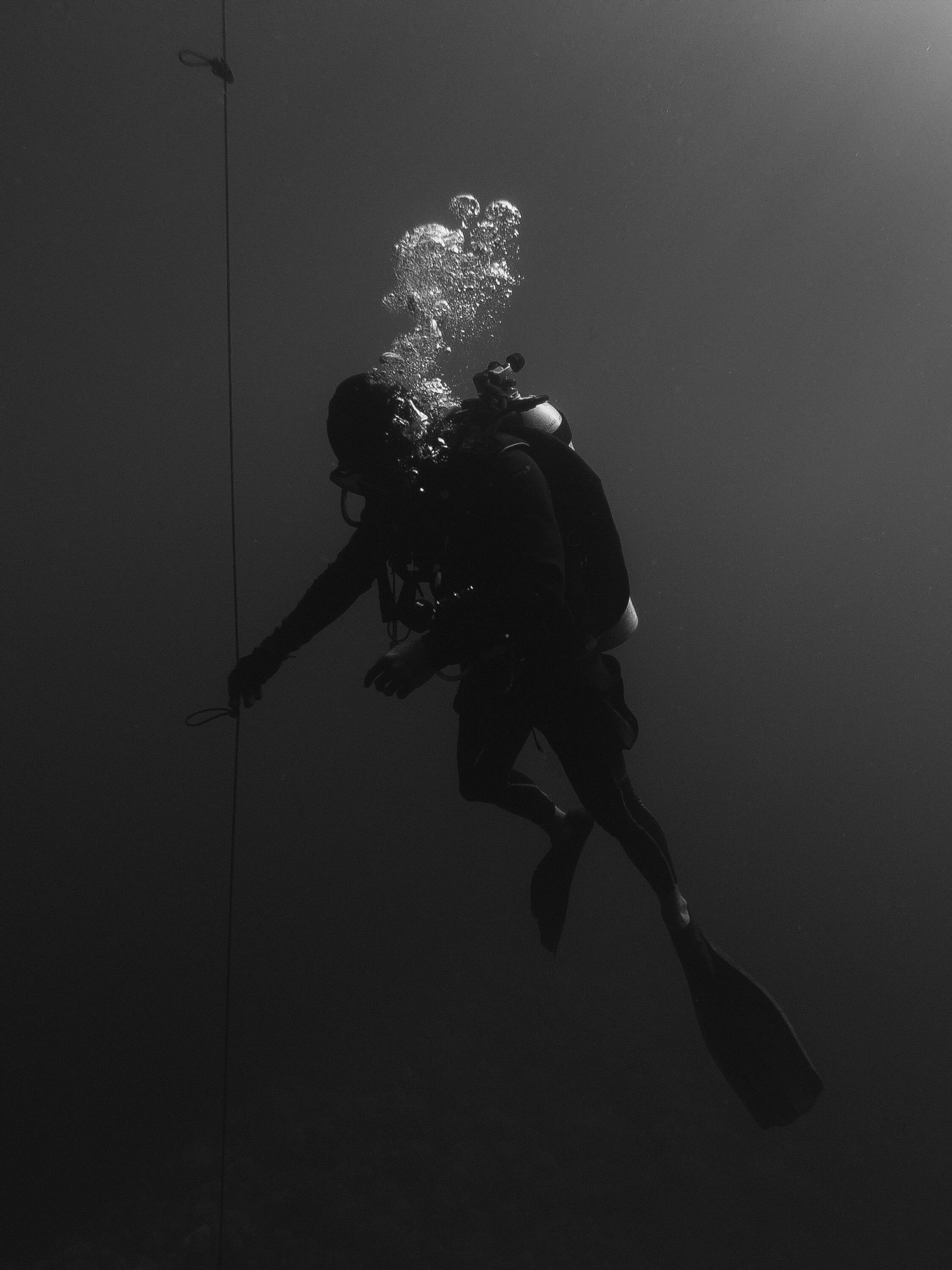 man scuba diving at night