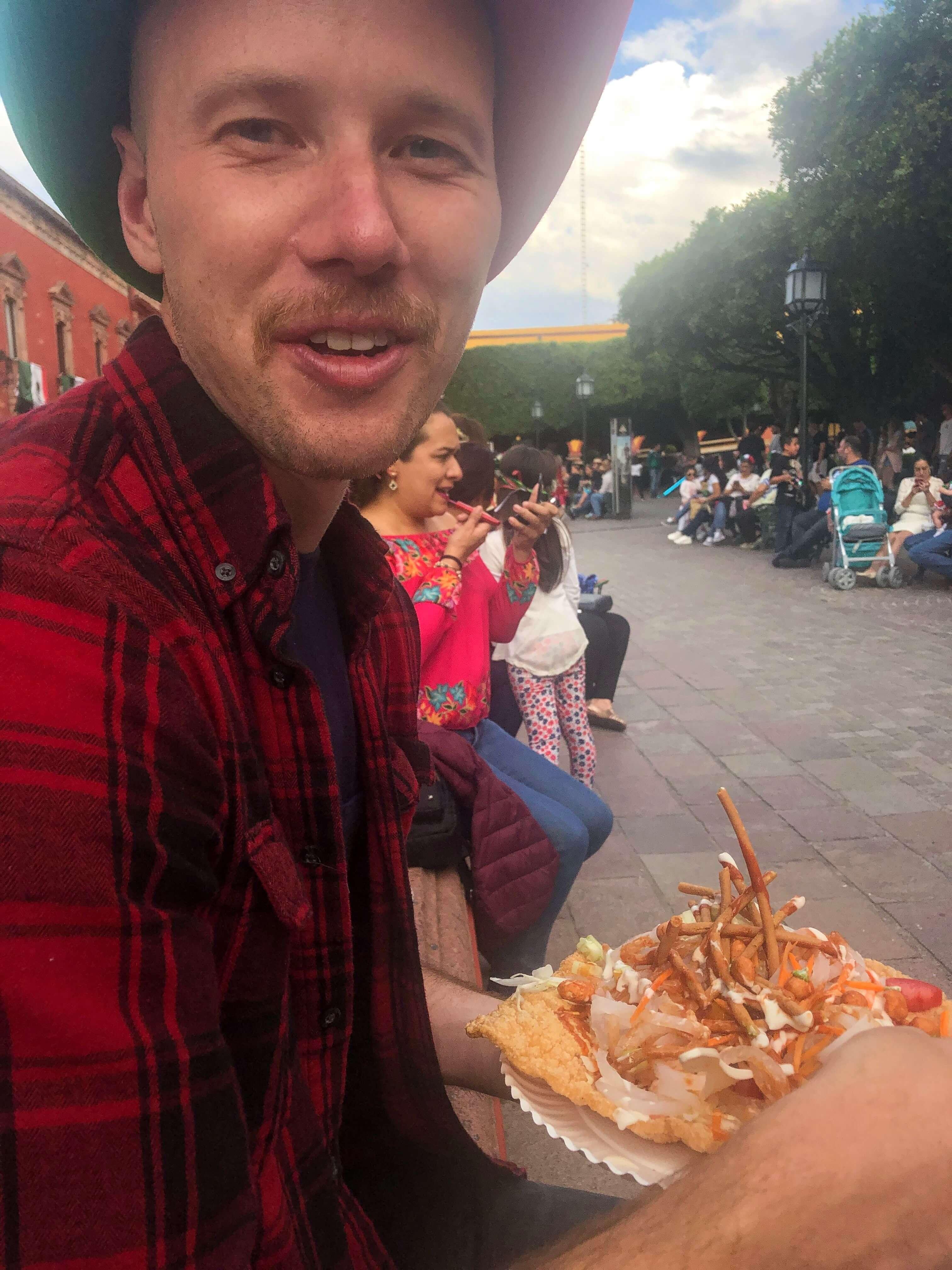 Dan eating chicarrone in San Miguel de Allende