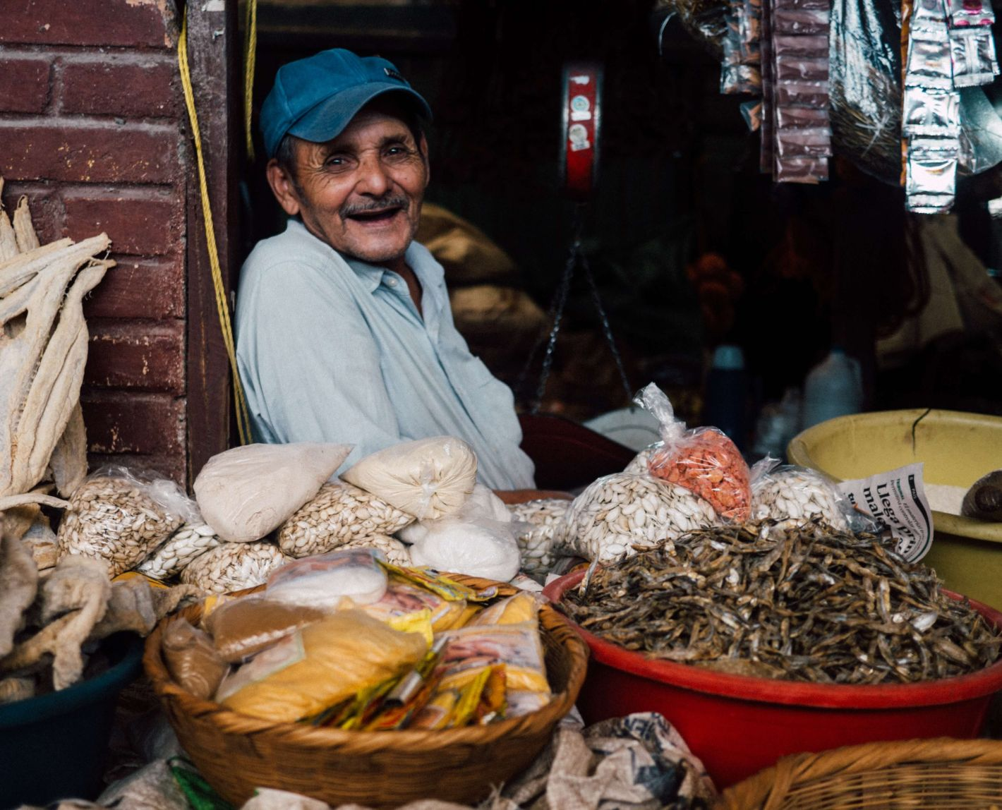 man selling food at a market in Honduras