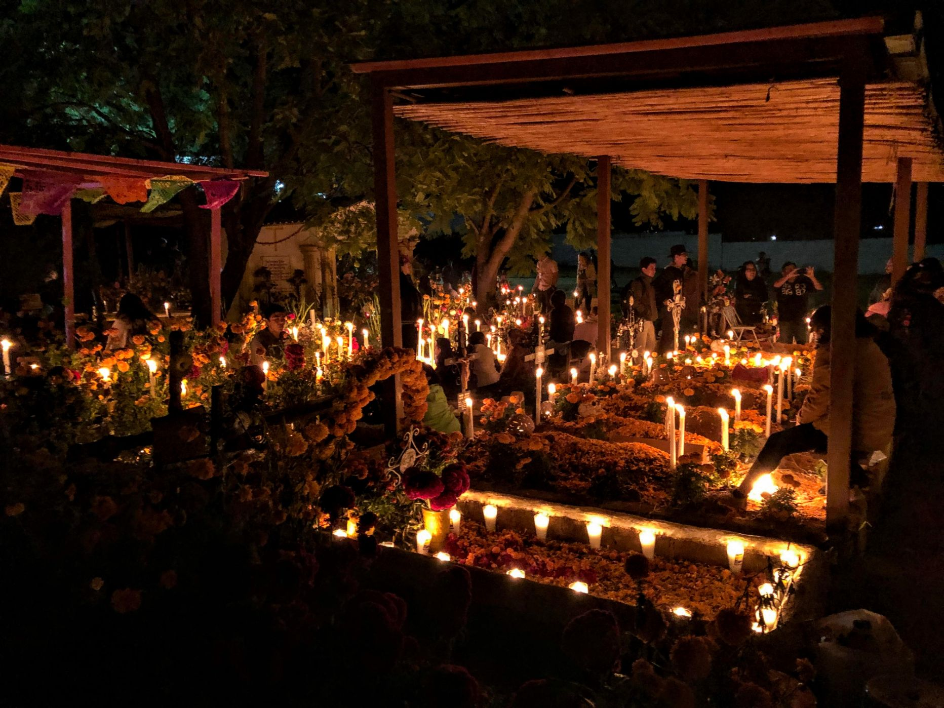 candle-lit vigil in the cemetery in Oaxaca