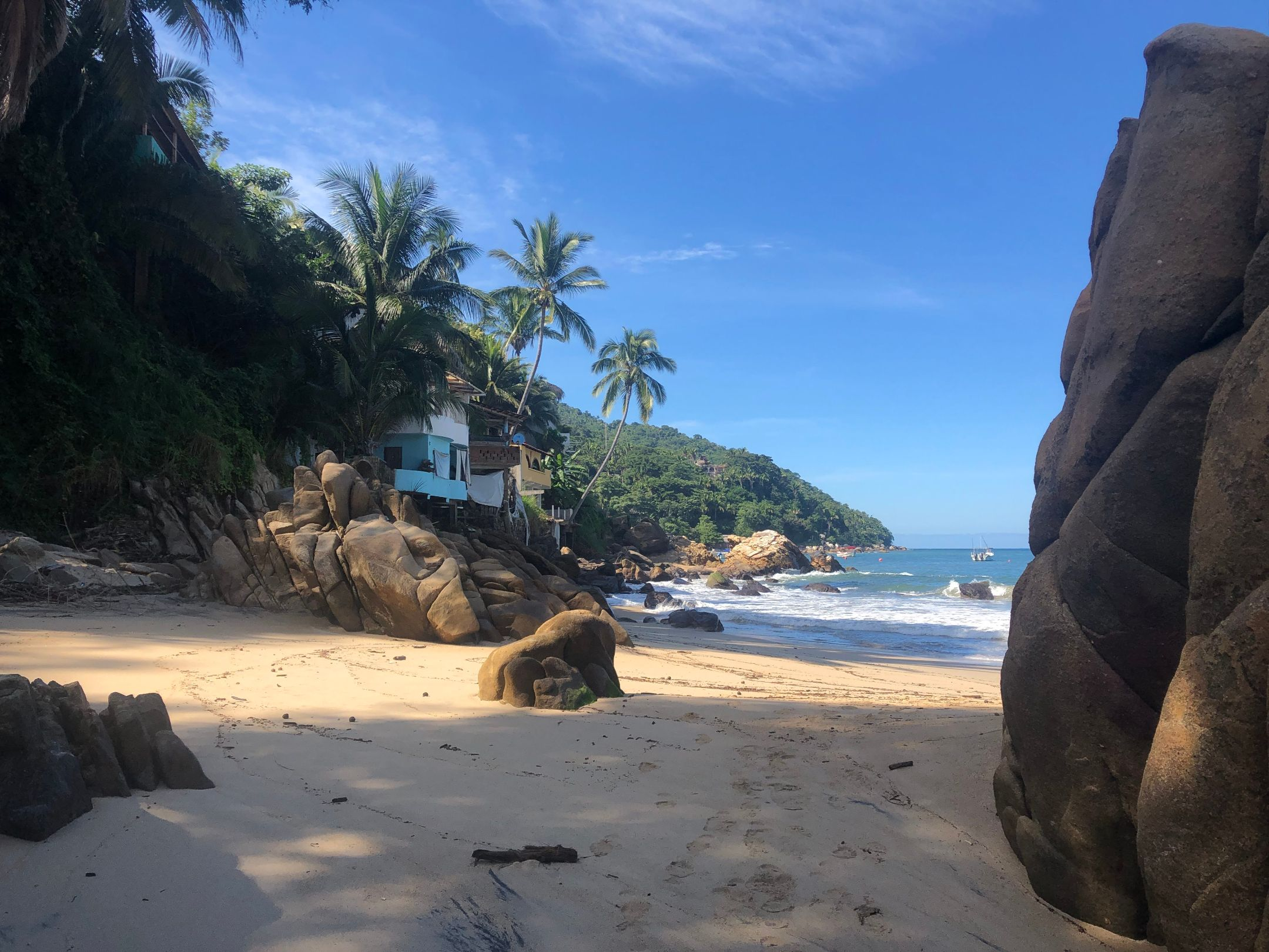 house, rocks, and palm trees on Yelapa beach
