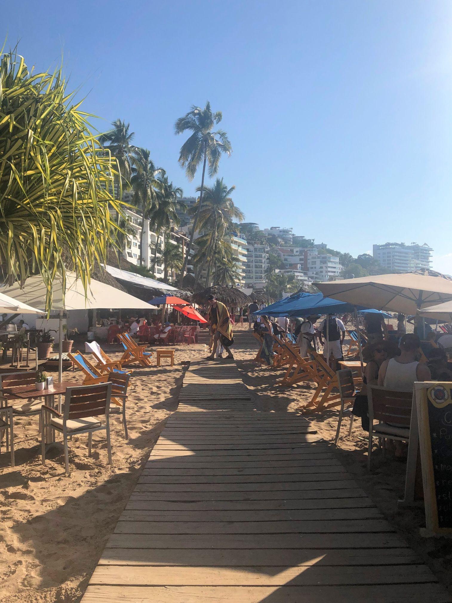 crowds along the Los Muertos beach boardwalk in Puerto Vallarta