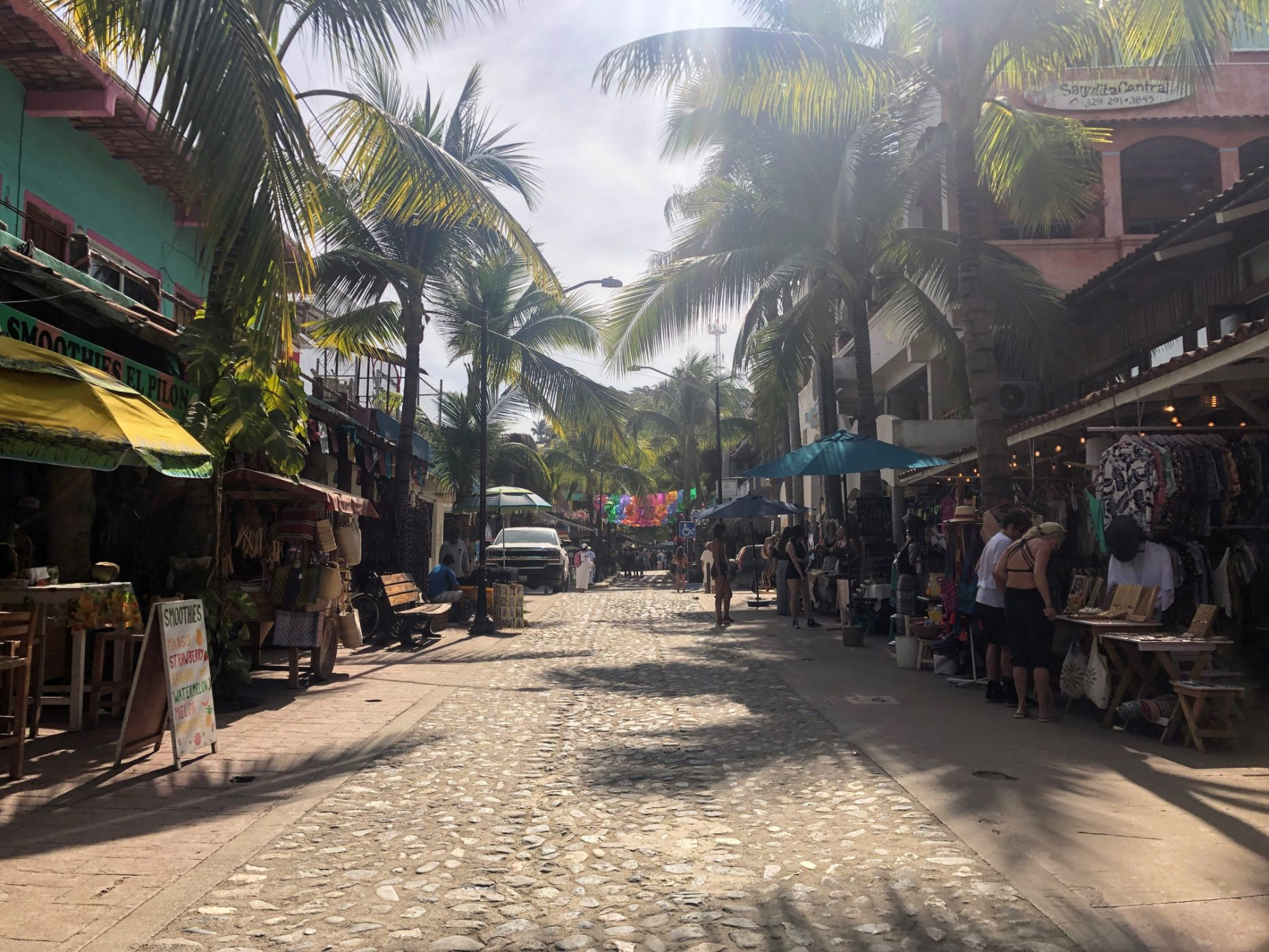 palm trees and boutique shops lining the streets in Sayulita