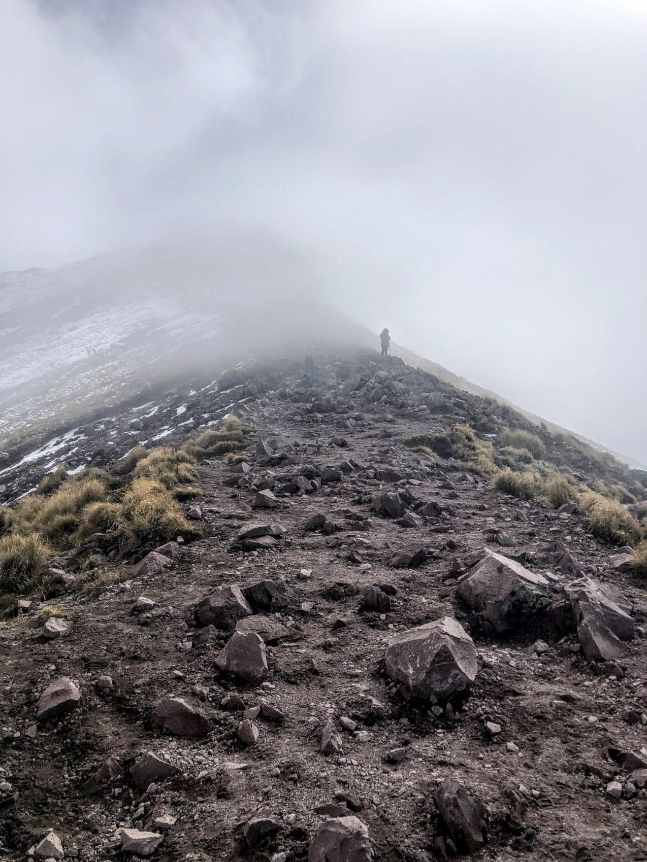 silhouetted climber in the mist on Malinche Volcano