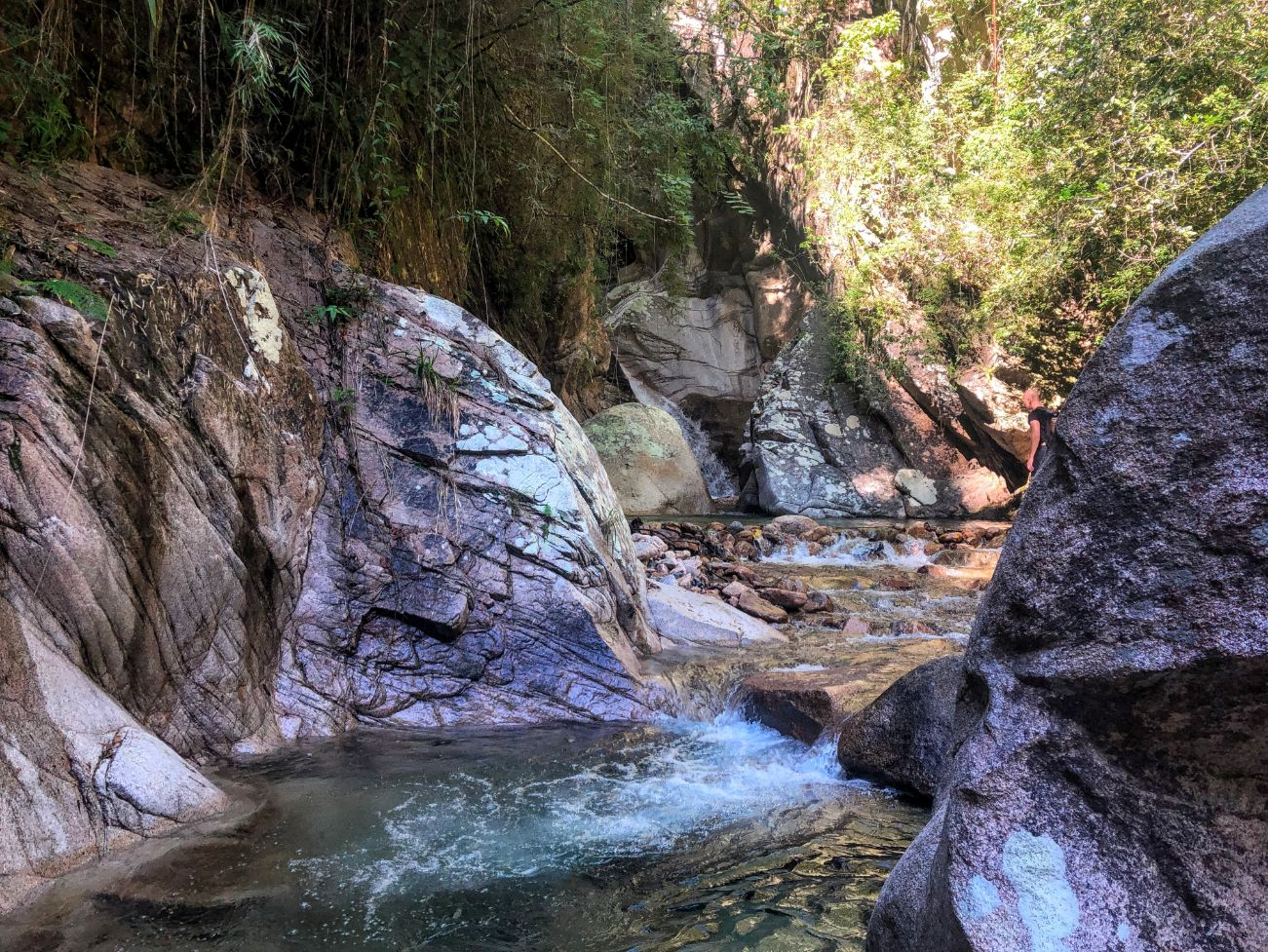 Large boulders and river swimming hole at the Nogalito Waterfall