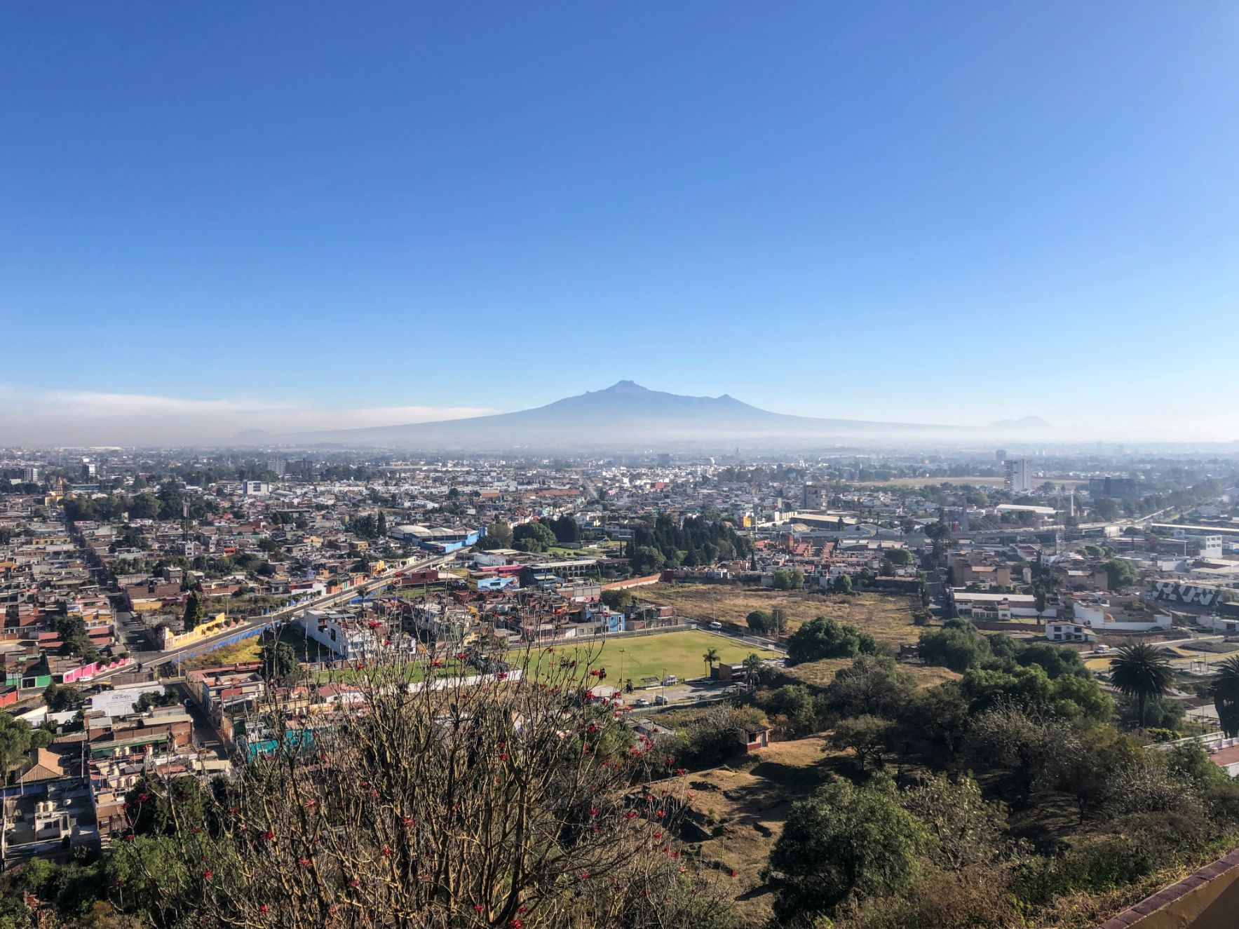 Aerial view of Puebla, Mexico with morning mist and a mountain in the background