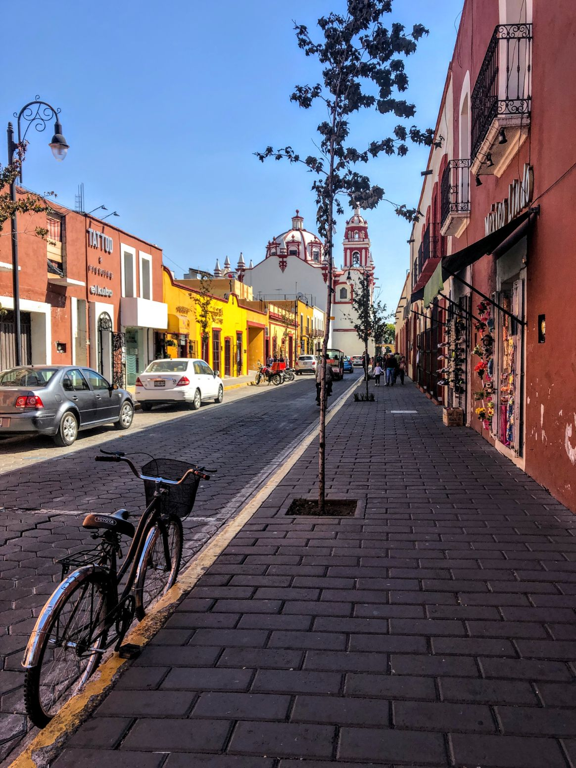 street with bike and colorful buildings in San Andres de Cholula