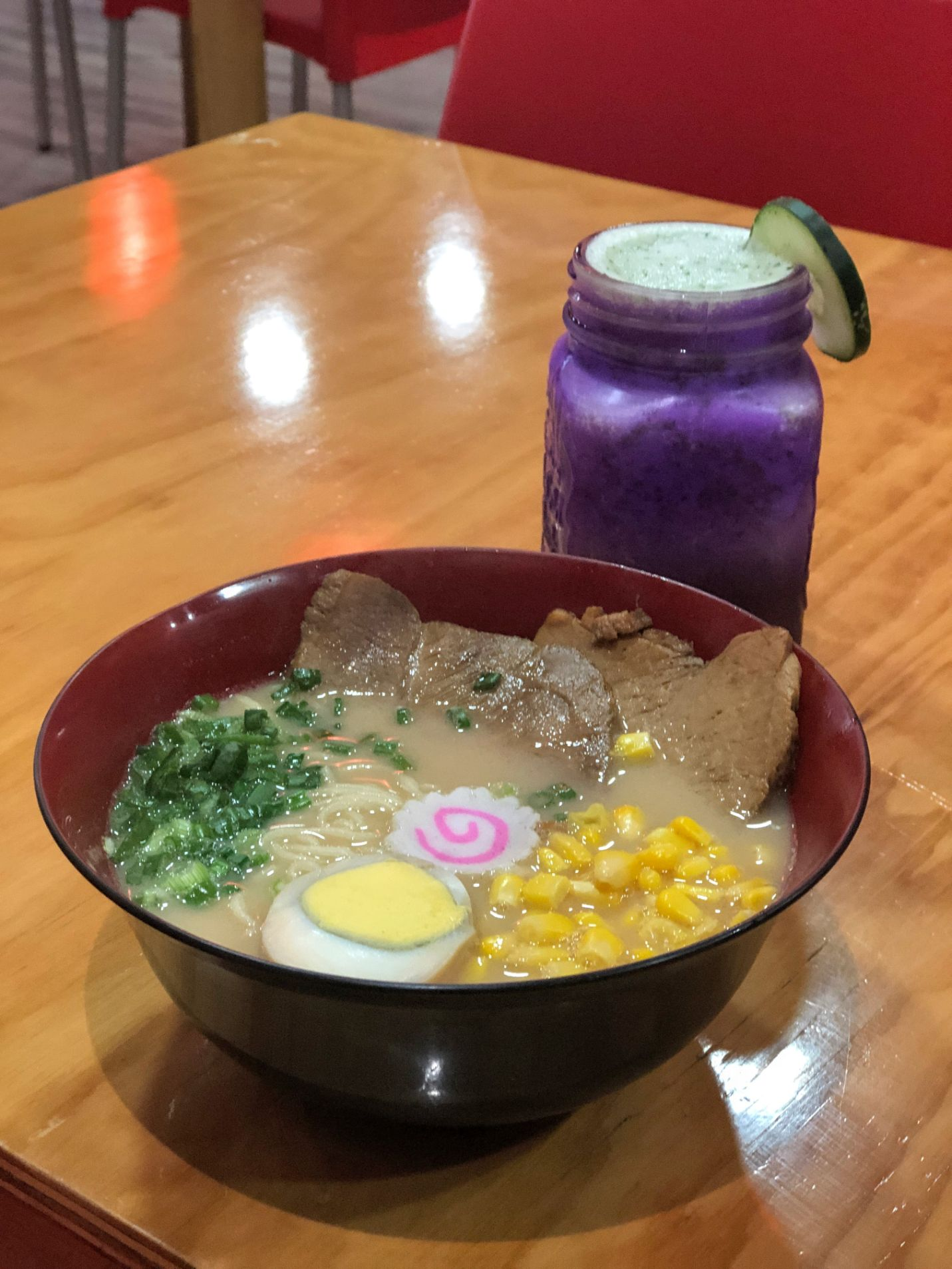 bowl of ramen and apple drink at Stop By Ramen in Puebla