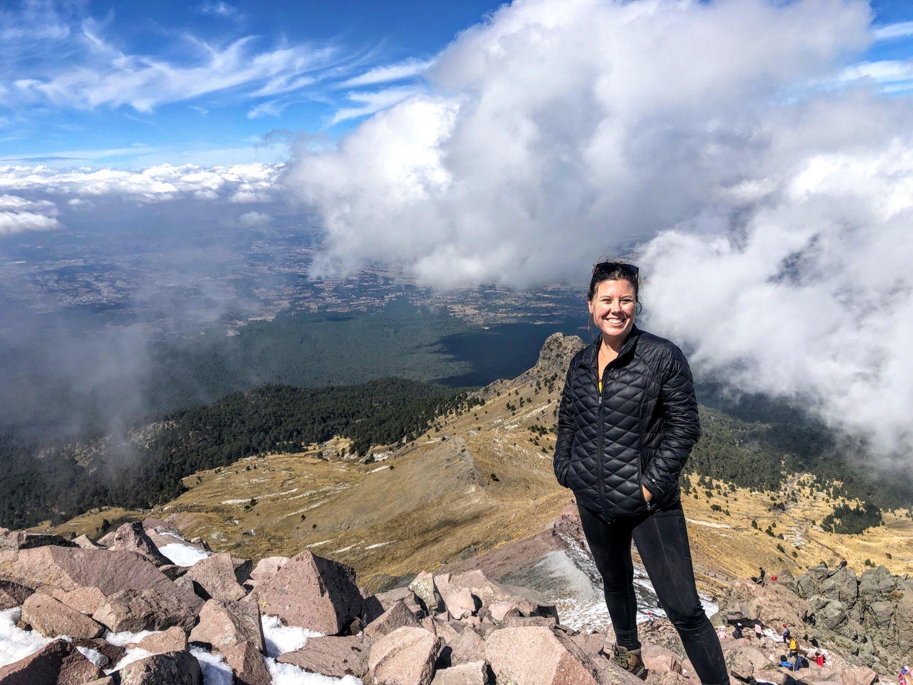 Di smiling at the peak of Malinche Volcano