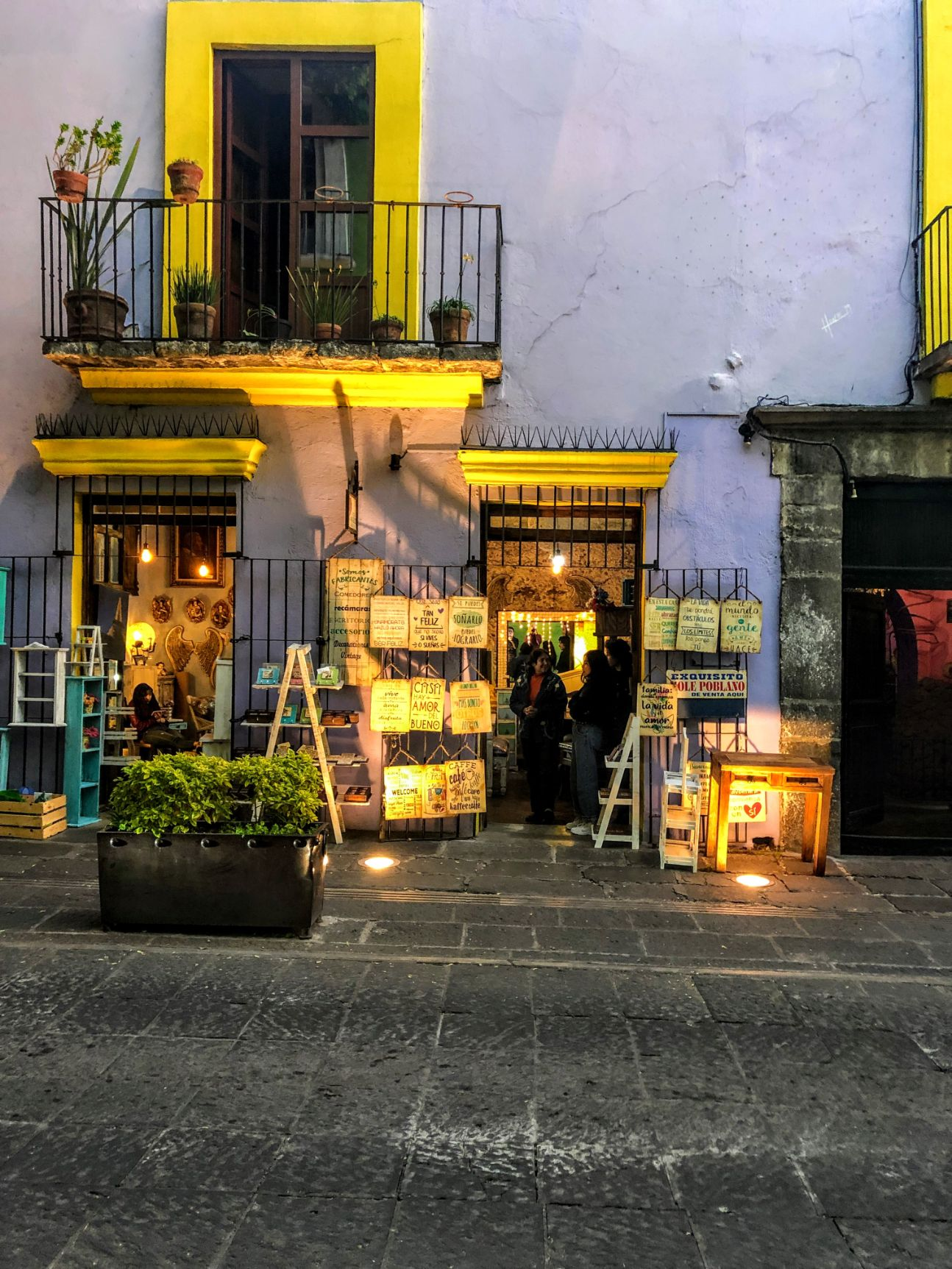 purple storefront with art and yellow wall accents