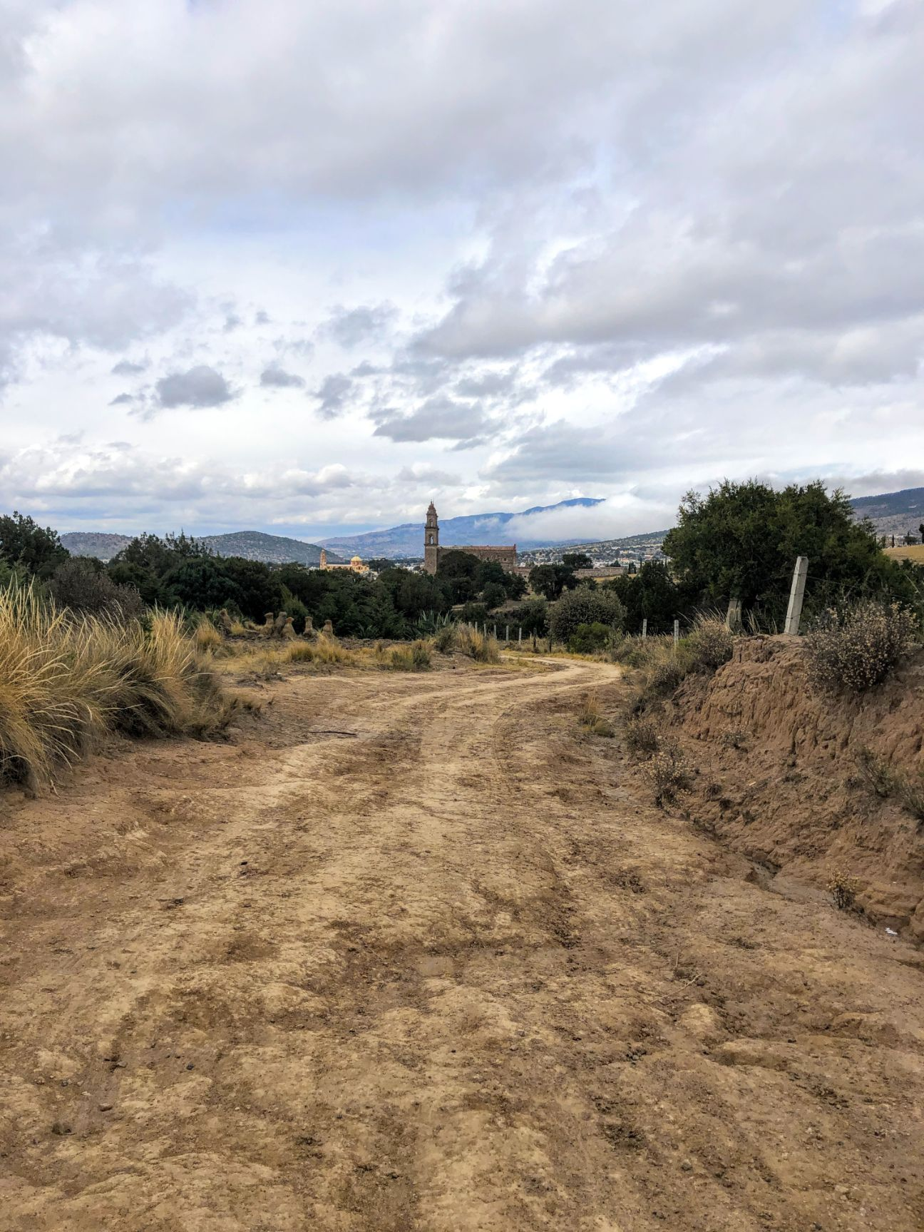 dirt road leading to the town of Tlaxco in the distance