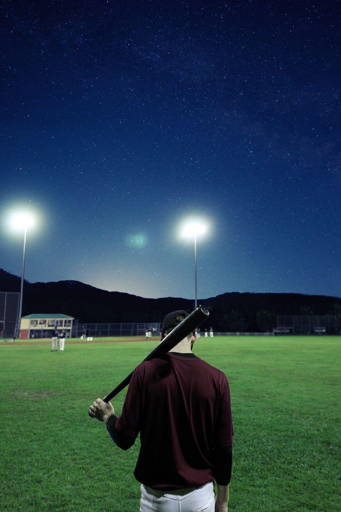 guy on a baseball field at night