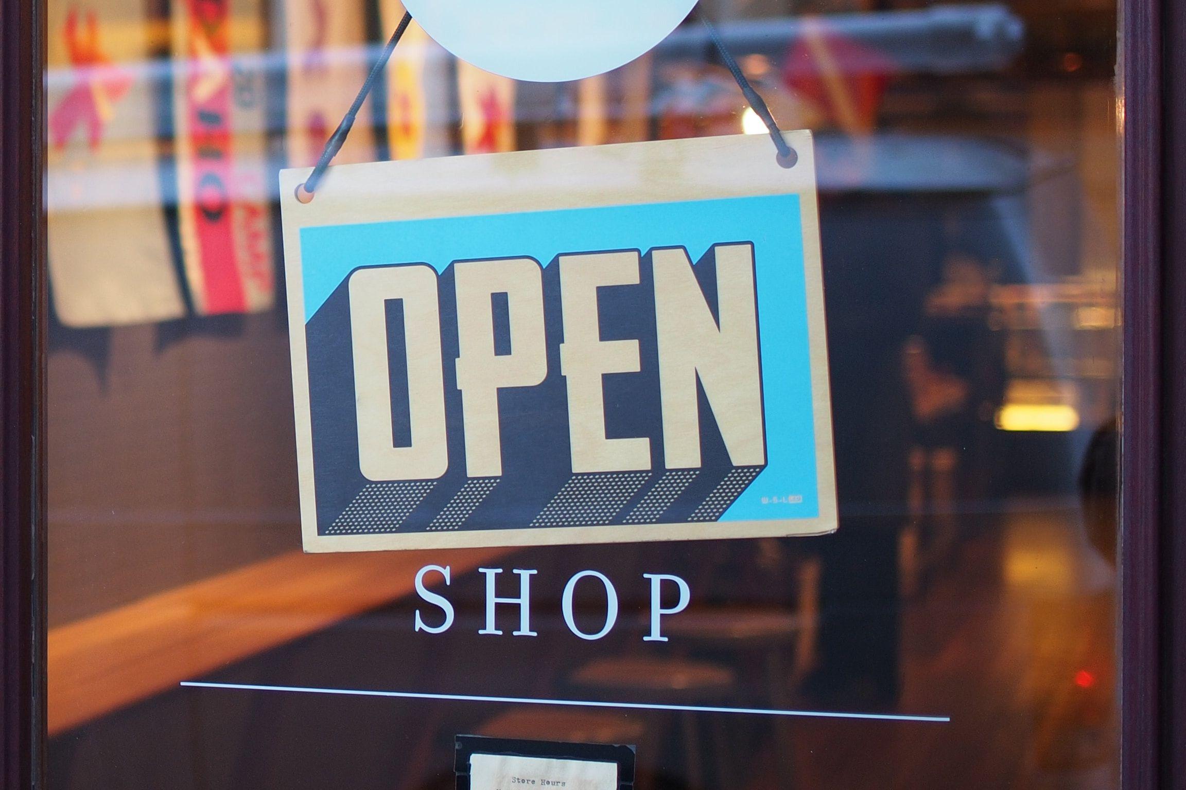 open sign on a boutique shop