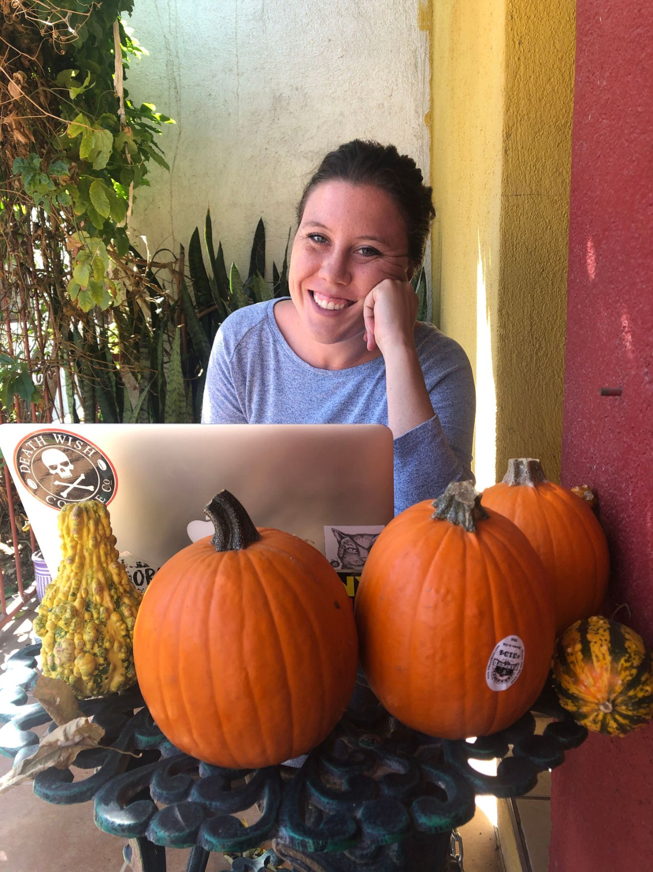 smiling on the front porch of our Airbnb in Oaxaca, Mexico
