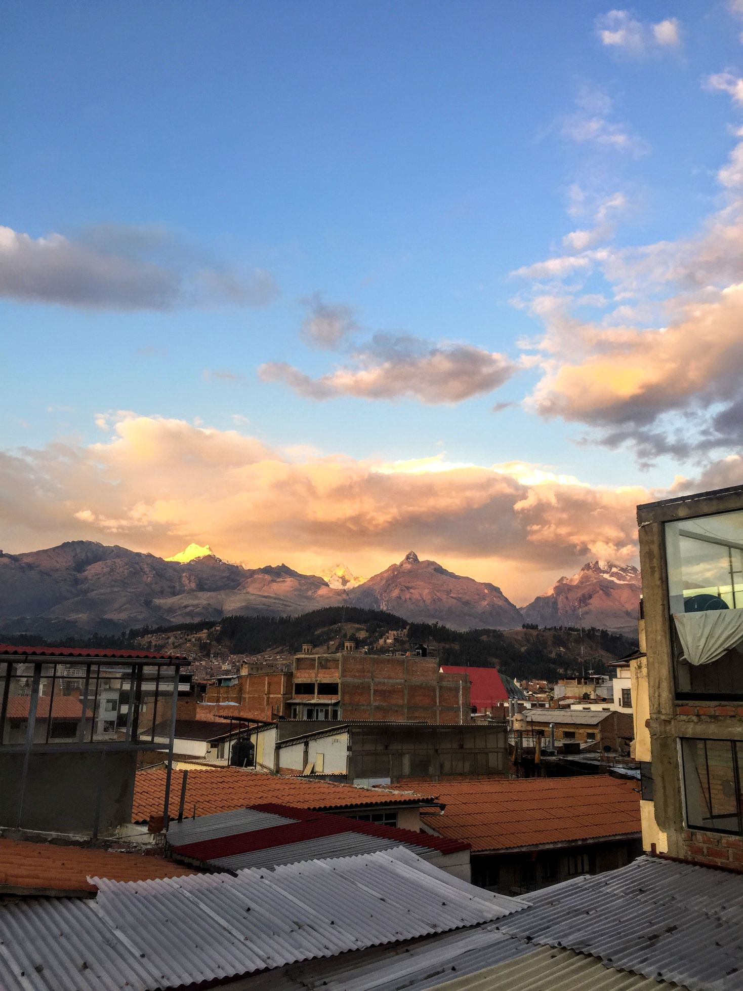 view of mountains at sunset over the town of Huaraz, Peru