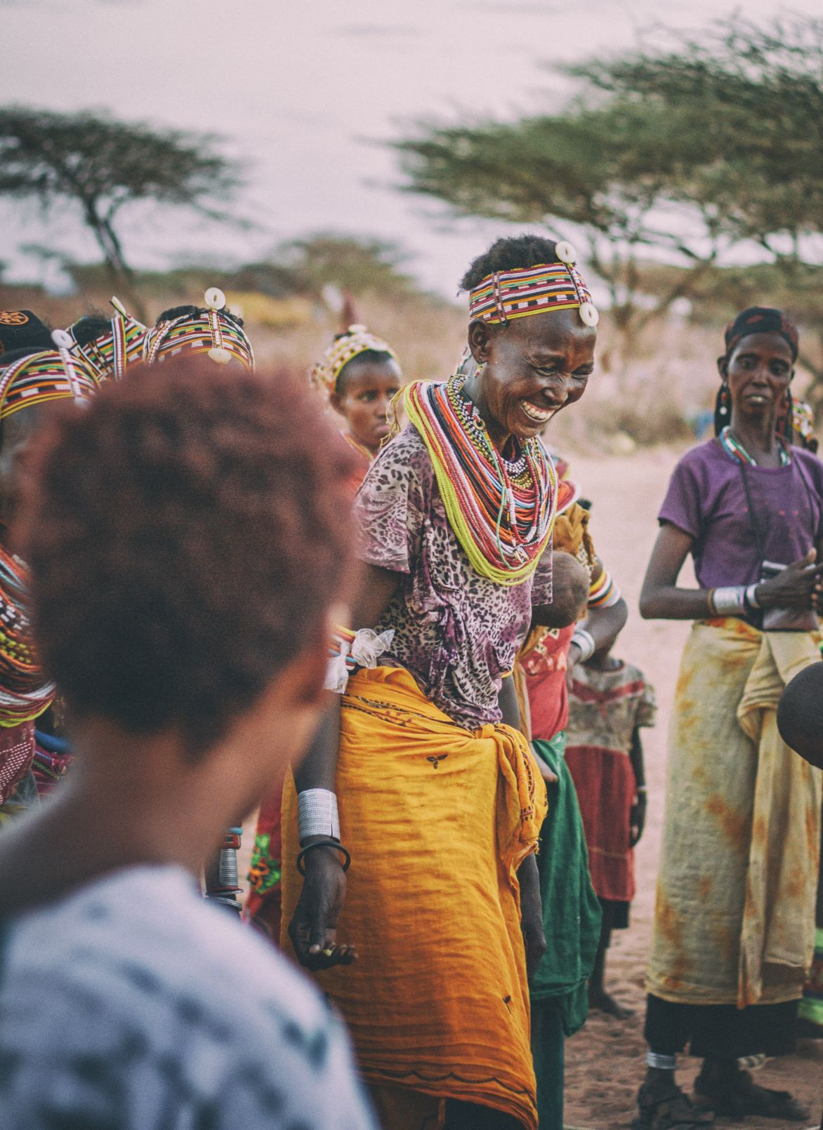 woman smiling and laughing in traditional dress in Africa