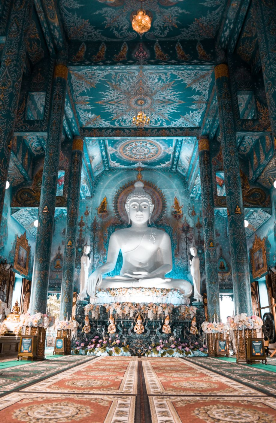 Blue temple with a buddha statue in Chiang Rai, Thailand
