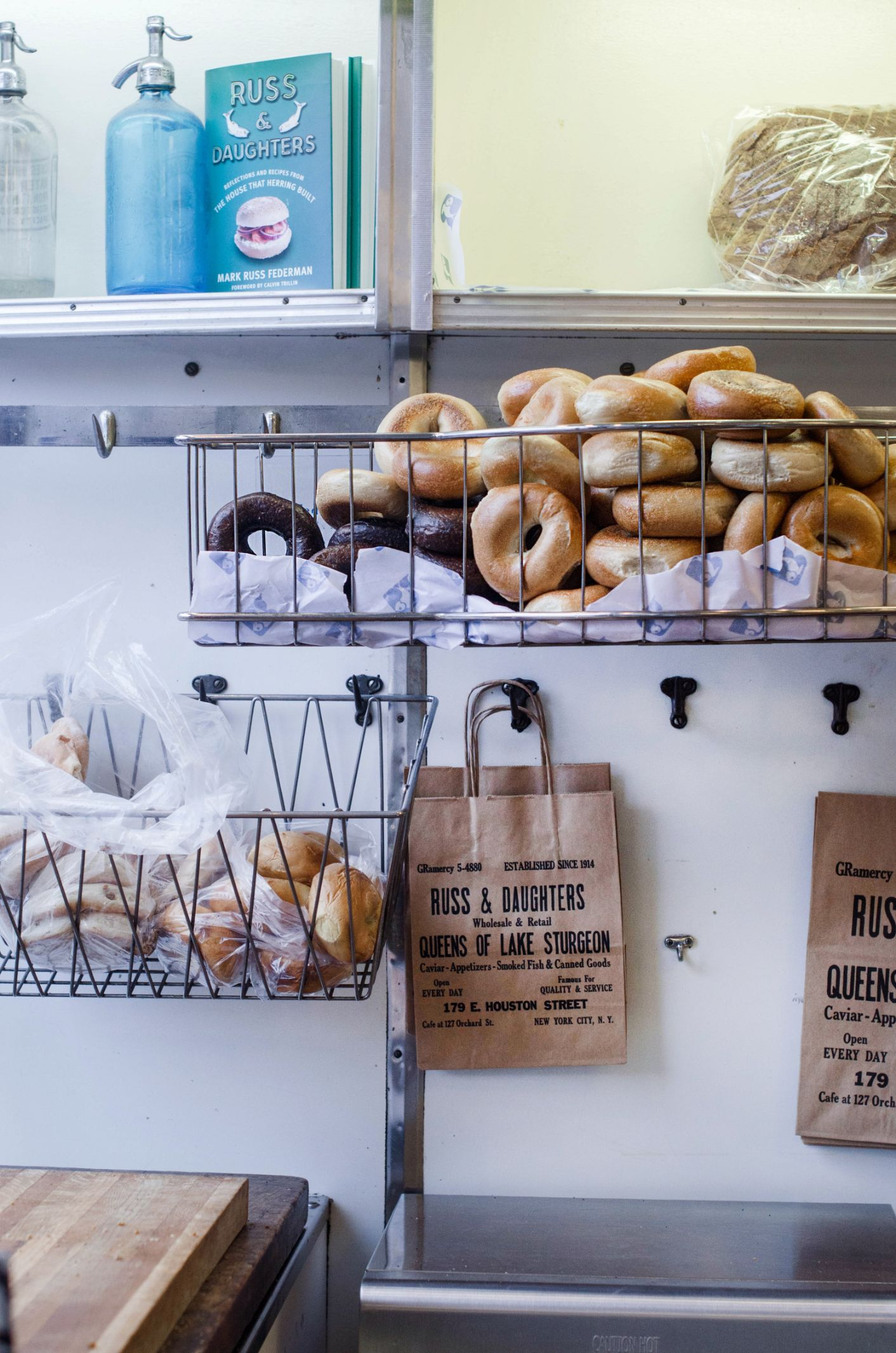 Bagels in a basket on the wall at Russ and Daughters