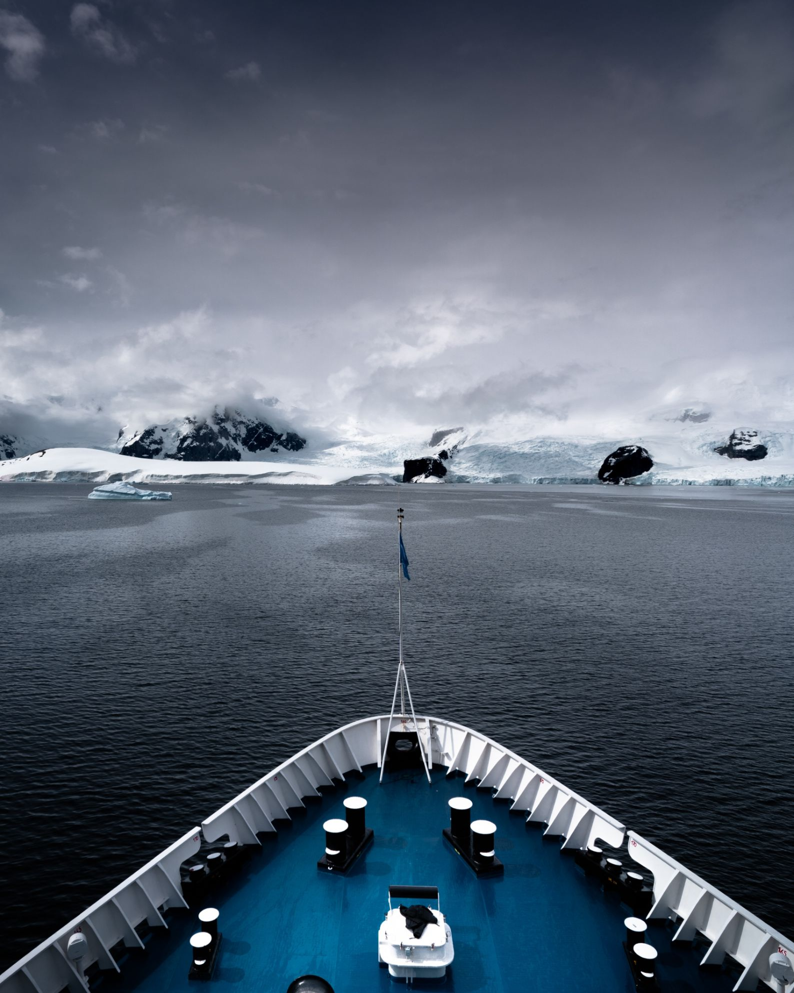 front of a ship sailing through the ice in Antarctica